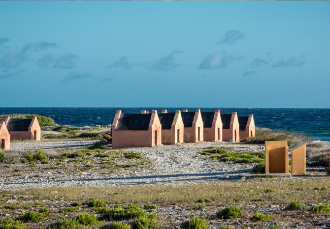 Learn something about the history of Bonaire and visit these little huts where slaves lived in
